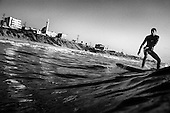Mahmoud Alyrashi surfs on edge of Gaza City, Gaza Strip.<br /> &quot;We want to show the world that we are not terrorists but are peaceful people. When I surf I feel free, like a bird feels when it flies.&quot;