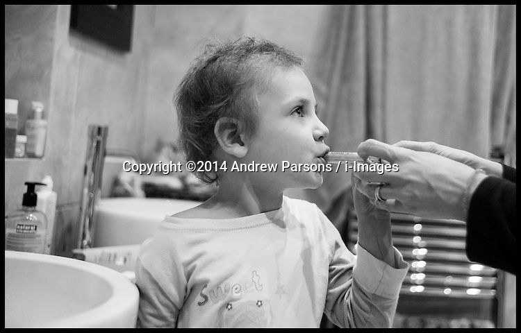 Image ©Licensed to i-Images Picture Agency. 31/10/2014. London, United Kingdom. A four year girl having her last dose of Mercaptopurine oral  Chemotherapy to treat Leukaemia. Picture by Andrew Parsons / i-Images