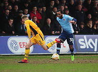 Blackpool's Nathan Delfouneso under pressure from Newport County's Dan Butler<br /> <br /> Photographer Kevin Barnes/CameraSport<br /> <br /> The EFL Sky Bet League Two - Saturday 18th March 2017 - Newport County v Blackpool - Rodney Parade - Newport<br /> <br /> World Copyright &copy; 2017 CameraSport. All rights reserved. 43 Linden Ave. Countesthorpe. Leicester. England. LE8 5PG - Tel: +44 (0) 116 277 4147 - admin@camerasport.com - www.camerasport.com