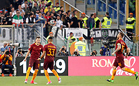 Calcio, Serie A: Roma vs Juventus. Roma, stadio Olimpico, 14 maggio 2017. <br /> Roma&rsquo;s Stephan El Shaarawy, left, celebrates with teammates Emerson Palmieri, center, and Daniele De Rossi after scoring during the Italian Serie A football match between Roma and Juventus at Rome's Olympic stadium, 14 May 2017. Roma won 3-1.<br /> UPDATE IMAGES PRESS/Riccardo De Luca
