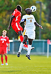 12 October 2011: University of Vermont Catamount Defender Yannick Lewis, a Senior from Toronto, Ontario, goes up against Dominique Badji in action against the Boston University Terriers at Centennial Field in Burlington, Vermont. The Catamounts were edged out 1-0 by the visiting Terriers. Mandatory Credit: Ed Wolfstein Photo