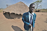 The United Methodist pastor outside his church sanctuary in Logo, a small village in Southern Sudan's Central Equatoria State.