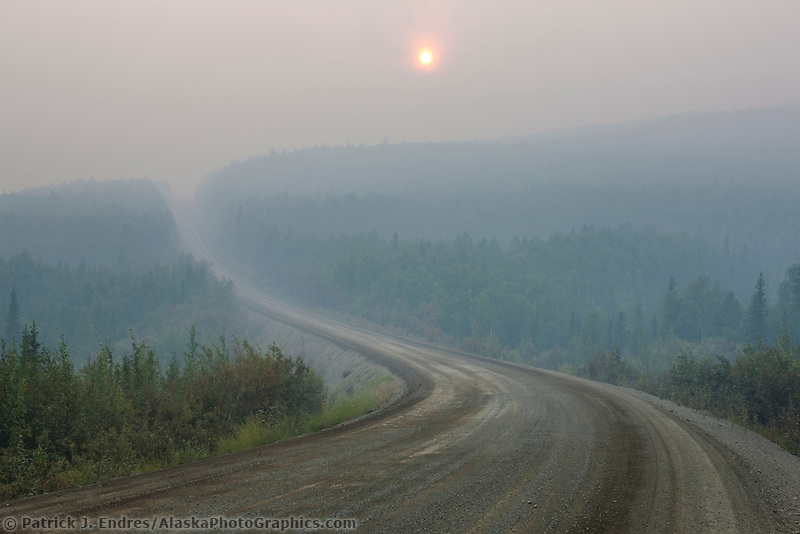 Sun barely visible through thick forest fire smoke along the James Dalton highway, arctic, Alaska.