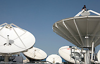 Satellite dishes on the roof at news channel Al Jazeera in Doha.