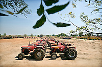 Outside Juba new tractors, donated by the government of India, lie idle waiting to be used in the reconstruction of South Sudan. Central Equatoria, South Sudan.