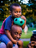 Four-year old Kaleb and father, Getahun Geleta wait for the fireworks to start at the 267th birthday celebration of the city of Alexandria, Virginia