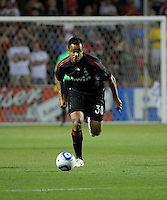 AC Milan midfielder Mancini (30) dribbles down the field.  AC Milan defeated the Chicago Fire 1-0 at Toyota Park in Bridgeview, IL on May 30, 2010.