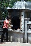 Hanoi, Vietnam, Worshiping at Ngoc Son, (Jade Mountain) Temple. photo taken July 2008.