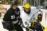 NCAA HOCKEY: MAR 13 Western Michigan at Michigan. Aaron Palushaj (8 UM), Tyler Ludwig (21) Michigan defeated Western Michigan 5-2