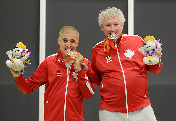 Toronto, ON - Aug 13 2015 - Ian Kent and Masoud Mojtahed receive their Silver Medal for the Men's Team Class 6-8 Final in the Atos Markham Parapan Am Centre during the Toronto 2015 Parapan American Games  (Photo: Matthew Murnaghan/Canadian Paralympic Committee)