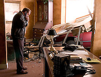 Bradley Griggs talks on his cell phone in Pastor Dusty McLemore's office at Lindsay Lane Baptist Church after a car crashed through the wall Thursday afternoon.  McLemore was not in the office at the time of the wreck.  photo by Gary Cosby Jr.  1/25/07