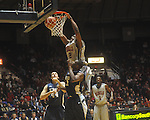 "Mississippi forward Reginald Buckner (2) dunks over East Tennessee State's J.C. Ward (44) and East Tennessee State's Isiah Brown (41) at the C.M. ""Tad"" Smith Coliseum in Oxford, Miss. on Saturday, December 18, 2010. Ole Miss won 71-50 and Buckner scored 16 points and blocked 7 shots."