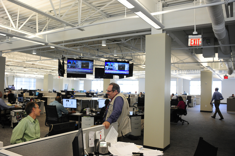 Post-Gazette's new newsroom at 358 North Shore Dr. in Pittsburgh.  Here reporter Rich Lord and photographer Larry Roberts confer on a project. <br /> <br /> Tim Martin AME News for the Pittsburgh Post-Gazette retires September, 2015