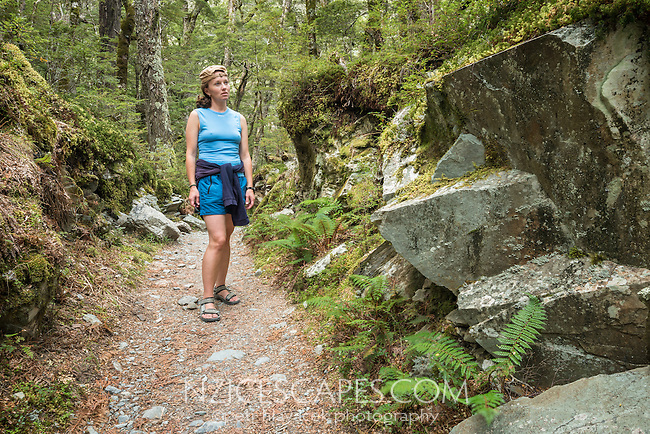 Young female hiker on Routeburn Track, Mt. Aspiring National Park, Central Otago, UNESCO World Heritage Area, New Zealand, NZ