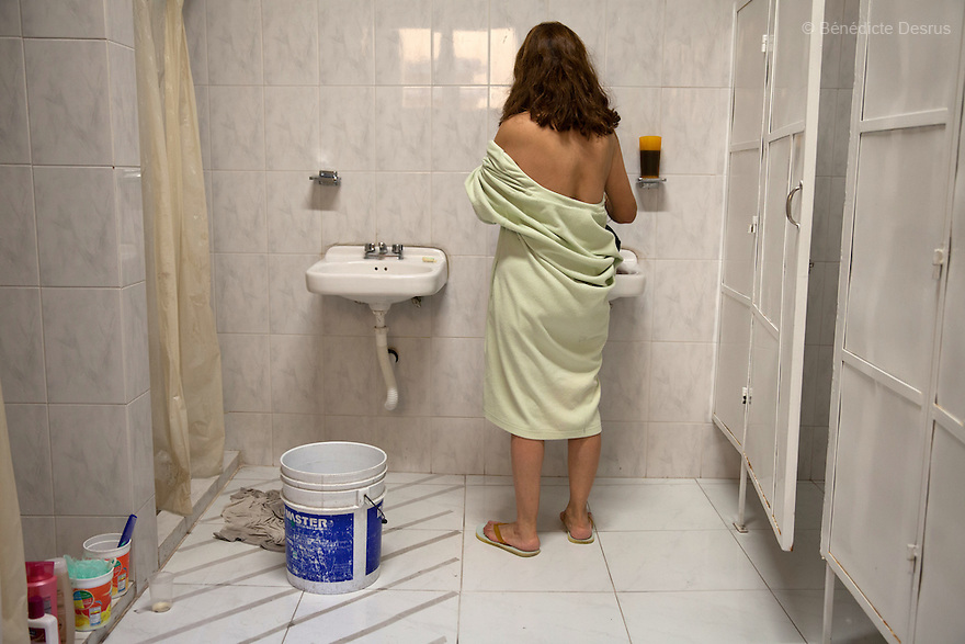 Laeticia, a resident of Casa Xochiquetzal, takes a shower at the shelter in Mexico City, Mexico on September 3, 2013. Casa Xochiquetzal is a shelter for elderly sex workers in Mexico City. It gives the women refuge, food, health services, a space to learn about their human rights and courses to help them rediscover their self-confidence and deal with traumatic aspects of their lives. Casa Xochiquetzal provides a space to age with dignity for a group of vulnerable women who are often invisible to society at large. It is the only such shelter existing in Latin America. Photo by Bénédicte Desrus