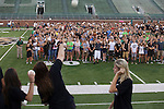 The Ohio Bobcats volleyball team throws out balls to students on the field of Peden Stadium after teaching them the fight song on Saturday, August 20, 2016. © Ohio University / Photo by Kaitlin Owens