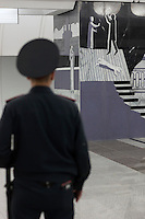 Moscow, Russia, 20/06/2010..A policeman looks at murals depicting Raskolnikov's double murder and Svidrigailov's suicide in Crime &amp; Punishment at the just-opened Dostoevsky metro station, the newest in Moscow's underground metro system. The station's opening was delayed by several weeks after psychiatrists claimed the gloomy and violent images in murals depicting scenes from Dostoevsky's novels would make the station a &quot;mecca for suicides&quot;.