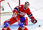 10 February 2010: Montreal Canadiens' goaltender Carey Price makes a second period save against the Washington Capitals at the Bell Centre in Montreal, Quebec, Canada. The Canadiens defeated the Capitals 6-5 in sudden death overtime, ending Washington's team-record winning streak at 14 games. Mandatory Credit: Ed Wolfstein Photo
