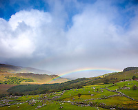 County Kerry, Ireland: A rainbow arches over Black Valley near Ladies View on the Ring of Kerry