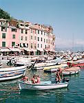 Family in boat in Portofino, Liguria, ITALY
