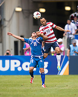 Landon Donovan (10) of the United States goes up for a header with Rodolfo Zelaya (11) of El Salvador during the quarterfinals of the CONCACAF Gold Cup at M&T Bank Stadium in Baltimore, MD.  The United States defeated El Salvador, 5-1.