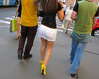 RUSSIA - Russland - MOSCOW, MOSKAU , woman with heigh heels and boys on TVERSKAYA street     &copy; Christian Jungeblodt