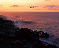 Helicopter over lava flow to sea, Big Island