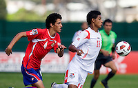 Jorman Aguilar (18) of Panama controls the ball in front of David Acuna (4) of Costa Rica during the quarterfinals of the CONCACAF Men's Under 17 Championship at Catherine Hall Stadium in Montego Bay, Jamaica. Panama defeated Costa Rica, 1-0.