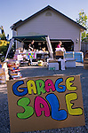 Residential neighborhood on a hot sunny summer day a family is having a garage sale in their front driveway Snohomish County Marysville Washington State USA