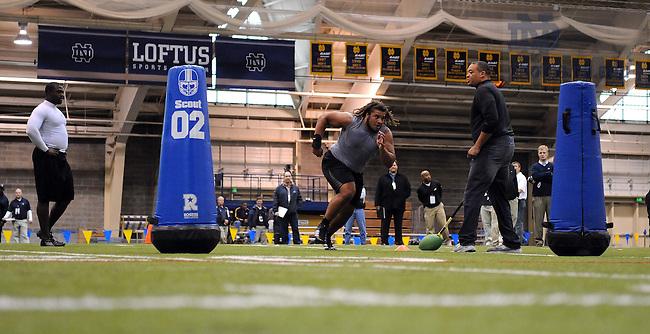 Mar. 19, 2008; South Bend, IN, USA: Notre Dame Fighting Irish defensive end Trevor Laws, center, runs a drill as defensive end Dwight Stephenson, Jr. watches during Notre Dame Pro Day at The Loftus Center.  Photo by Matt Cashore/University of Notre Dame