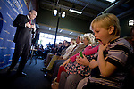 Logan Phillis, 7, of Ames Iowa, plays as Former Sen. Fred Thompson (R-Tenn.), and 2008 Republican presidential candidate, speaks to supporters at the Olde Maine Brewing Company in Ames, Iowa, Sunday December 30, 2007. (Brian Baer/  Sacramento Bee/  MCT)