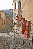 Macarons, almond bisquits. Patisserie shop in a steep cobble stone street. The town. Saint Emilion, Bordeaux, France