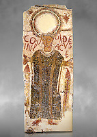 5th century Eastern Roman Byzantine  funerary mosaic from Tarbaka in the Roman province of Africa Proconsularis , present day Tunisia, with a crown at the top probably a Christogram  (Latin Monogramma Christi ) is a monogram used as an abbreviation for the name of Jesus Christ, with a figure below and a latin text for the deceased &quot; Covuldeus in peace&quot;. Either side of the figure are a lit candle which symbolises eternal faith. The Bardo National Museum, Tunis Tunisia. Against a grey art background.<br />
