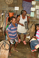 Man and his grandsons playing traditional Garifuna music in the Garifuna village of Triunfo de la Cruz, Honduras...