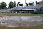 31 May 2016: Nova Southeastern players sit in the dugout during a lightning delay before the game. The Nova Southeastern University Sharks played the Lander University Bearcats in Game 8 of the 2016 NCAA Division II College World Series  at Coleman Field at the USA Baseball National Training Complex in Cary, North Carolina. Nova Southeastern won the game 12-1.