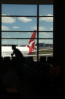 Passengers await their flights on Qantas at Sydney International airport on October 31st, 2011 in Sydney, Australia.  Flights resumed after approval from CASA was finally handed down around 4pm this afternoon. AFP Photo /Marianna Massey.
