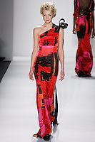Model walks runway in a brilliant brush strokes silk satin draped one-shoulder gown w/encrusted black crystal, trim and trails of black organza+satin+velvet ribbons, from the Zang Toi Fall 2012 &quot;Glamour At Gstaad&quot; collection, during Mercedes-Benz Fashion Week New York Fall 2012 at Lincoln Center.
