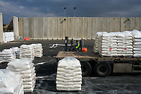 Kerem Shalom, Israel Dec. 29, 2008.After several weeks of total closure, Israel allows humanitarian supplies to be delivered to the Kerem Shalom terminal, where it will be unloaded from Israeli trucks before being reloaded on to Palestinian trucks. The decision to partially re-open the terminal comes simultaneously with Israel's most important military operation ever in the Gaza strip.
