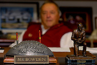 TALLAHASSEE, FL. 12/14/07-A metal football memento from the 1980 0range Bowl game against Oklahoma game holds a prominent place on Florida State Football Coach Bobby Bowden's desk. Bowden said the Seminoles' 17-18 loss to the Sooners was his most difficult bowl loss. FSU's appearance in the Music City Bowl on Jan. 1 will mark the 26th time Bowden has taken the Seminoles to a post-season game. With that game Bowden will pass former Nebraska Coach Tom Osborne's to hold the record for taking one school to the most consecutive bowl games...COLIN HACKLEY PHOTO