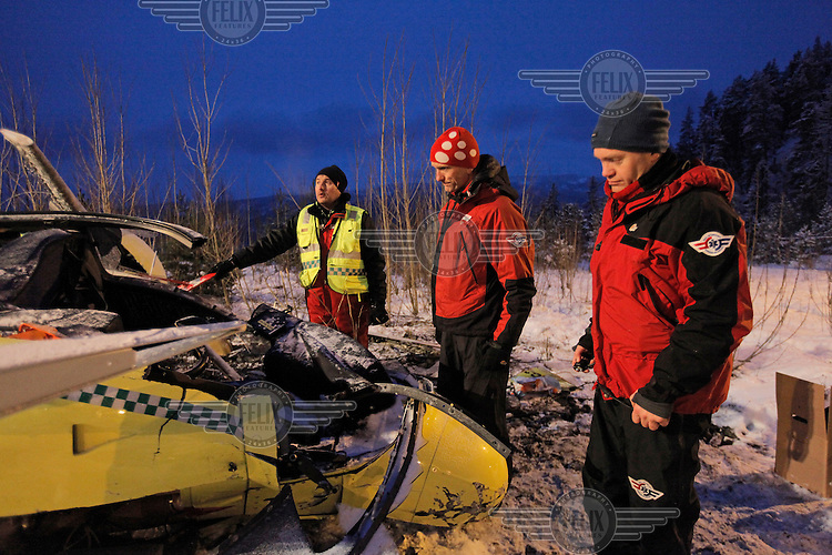 NLA staff inspect the wreckage. Norwegian Air Ambulance helicopter crash after striking power lines. It was about to land at the site of a traffic accident. The pilot and doctor were killed, while the rescue paramedic was severely injured. <br /> The helicopter was an Eurocopter EC 135.