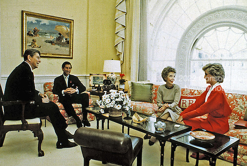 In this photo provided by the White House, United States President Ronald Reagan and First Lady Nancy Reagan have tea with Prince Charles and Princess Diana in the White House Residence in Washington, DC on November 9, 1985.<br /> Credit: The White House via CNP