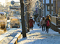 January 24, 2012, Tokorozawa, Japan - Commuters make their way down the frozen streets in Tokorozawa, Tokyos western bedtown suburb, on Tuesday, January 24, 2012. Snow fell in the Metropolitan Tokyo area from Monday night through early Tuesday morning, causing disruption of transportation services and people to slip and suffer injuries. (Photo by Natsuki Sakai/AFLO) AYF -mis-