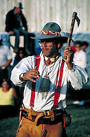 Mountainman competes in tomahawk hawk throwing contest. buckskin clothing, weapons, accessiories. Mountain Man. Fort Bridger Wyoming.