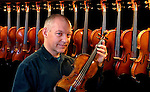 David Kerr with his newest acquisition, he having many fine instruments at his Dave Kerr Violin Shop.