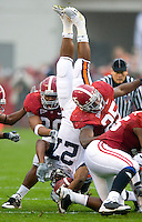 Alabama linebackers Dont'a Hightower and Rolando McClain upend Auburn running back Mario Fannin.  Photo by Gary Cosby Jr.   11/29/08