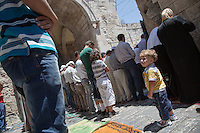 Palestinian Muslim worshippers praying next to the Al-Aqsa Mosque in Jerusalem's Old City on July 26, 2013. Muslim worshippers attended the third Friday prayers of the holy month of Ramadan at the Al-Aqsa Mosque. Throughout the Ramadan, followers are required to abstain from food, drink and sex from dawn to dusk. Photo by Oren Nahshon
