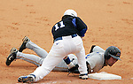 Gunner Glad tags out a Morehead State player at first base during the third inning of UK's win over Morehead State on Tuesday, March 2, 2010. Photo by Britney McIntosh | Staff