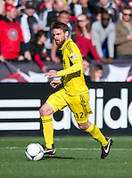 Eddie Gaven (12) of the Columbus Crew brings the ball forward during the game at RFK Stadium in Washington, DC.  Columbus Crew defeated D.C. United, 2-1.