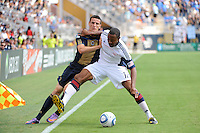 Cory Gibbs (12) of the New England Revolution holds off Sebastien Le Toux (9) of the Philadelphia Union. The Philadelphia Union and the New England Revolution  played to a 1-1 tie during a Major League Soccer (MLS) match at PPL Park in Chester, PA, on July 31, 2010.