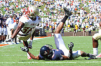 Oct 2, 2010; Charlottesville, VA, USA; Florida State Seminoles running back Jermaine Thomas (38) flips over Virginia Cavaliers cornerback Chase Minnifield (13) staying on his feet for a touchdown during the first half of the game at Scott Stadium.  Photo/The Daily Progress/Andrew Shurtleff